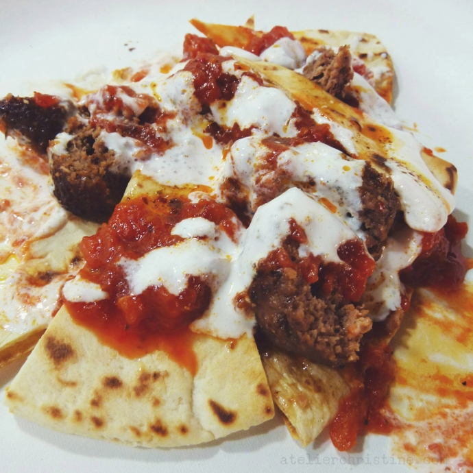 Grilled Beef Patties with Tomato Sauce + Yogurt on Pita Bread.